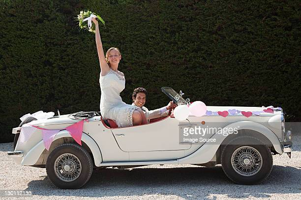 newlyweds leaving for honeymoon in vintage car - newlywed stock pictures, royalty-free photos & images