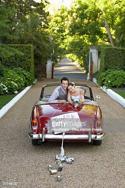 newlyweds leaving wedding - newlywed stock pictures, royalty-free photos & images