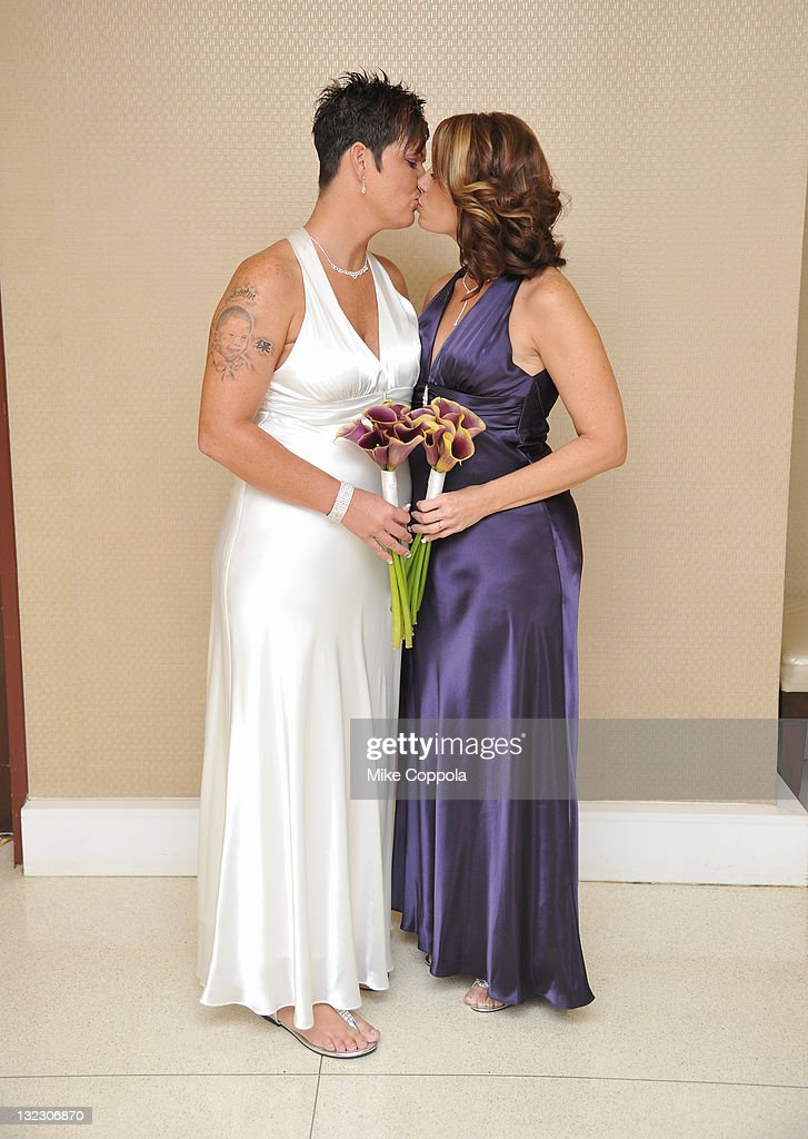 Newlyweds Melissa and Sheila pose at a wedding for 11 couples at the Crowne Plaza Times Square on November 11, 2011 in New York City.