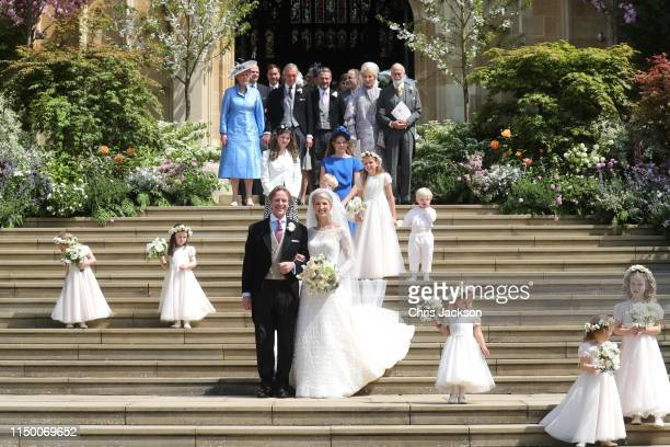 Newlyweds Mr Thomas Kingston and Lady Gabriella Windsor pose on the steps of the chapel with their bridesmaids page boys and guests after their...