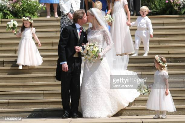 Newlyweds Mr Thomas Kingston and Lady Gabriella Windsor share a kiss on the steps of the chapel after their wedding at St George's Chapel on May 18...