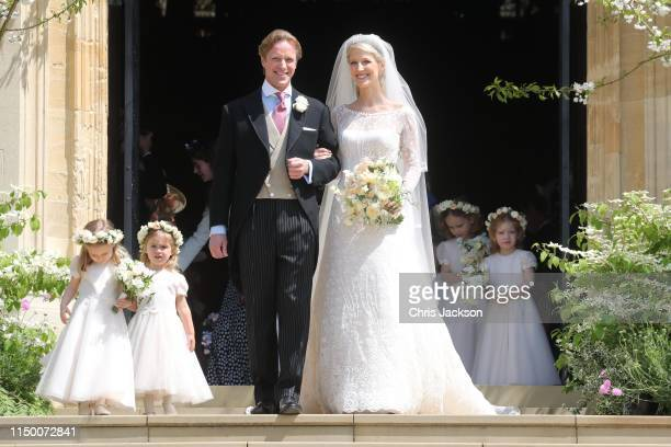 Newlyweds Mr Thomas Kingston and Lady Gabriella Windsor smile on the steps of the chapel after their wedding at St George's Chapel on May 18 2019 in...