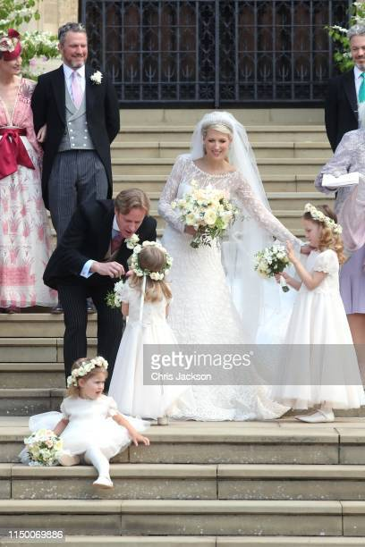 Newlyweds Mr Thomas Kingston and Lady Gabriella Windsor with their bridesmaids and guests on the steps of the chapel after their wedding at St...