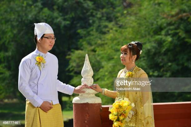 Newly-weds of Myanmar in Myanmar style. This photo was taken at Mandalay Palace. The Palace is the last royal palace of the last Burmese monarchy,...