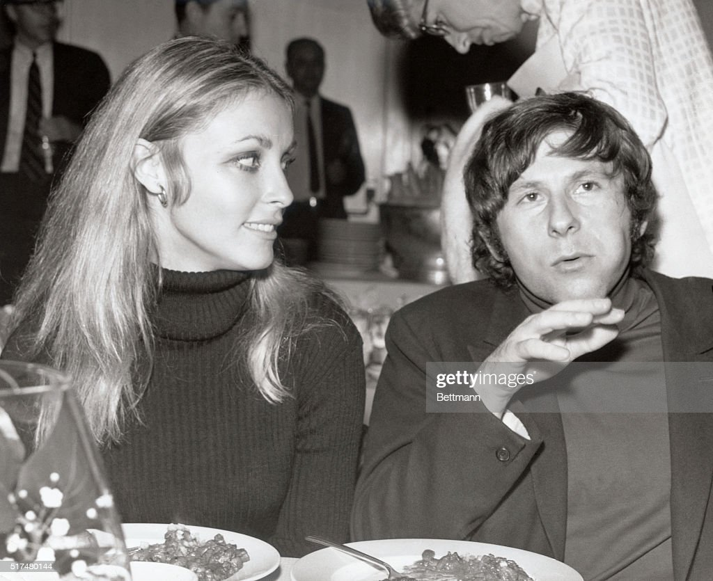 Roman Polanski and Sharon Tate Sitting at Table for Meal : News Photo