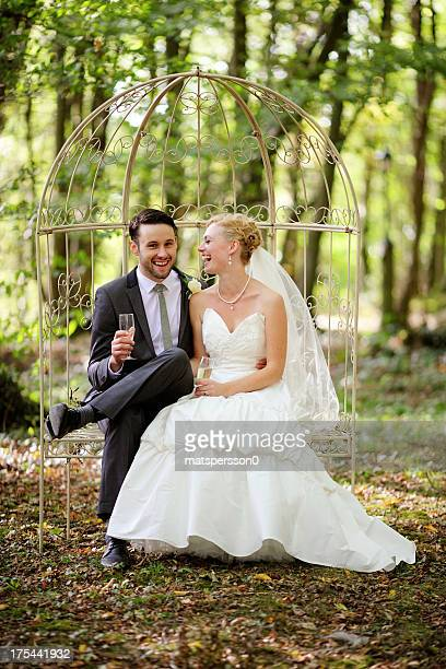 Newlyweds sitting and laughing together