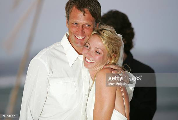 Newlyweds Skateboarder Tony Hawk and Lhotse Merriam pose for a photo at their wedding ceremony January 12 2006 on the Island of Tavarua in Fiji