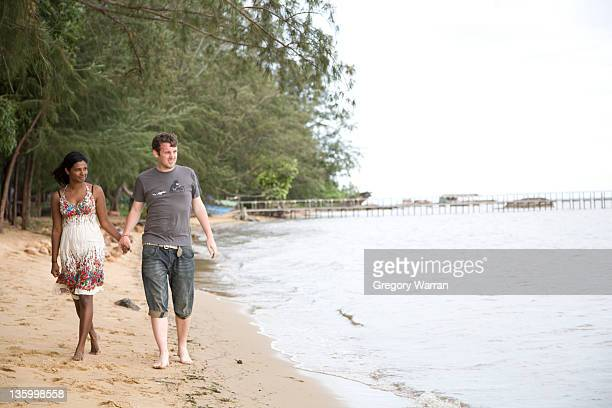 Newlyweds stroll along beach 2 - Kampot