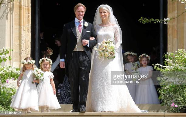 TOPSHOT Newlyweds Thomas Kingston and Lady Gabriella Windsor pose on the steps of St George's Chapel in Windsor Castle Windsor west of London on May...