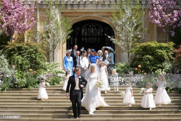 Newlyweds Thomas Kingston and Lady Gabriella Windsor walk down the steps with their bridesmaids, page boys and guests after their wedding ceremony,...