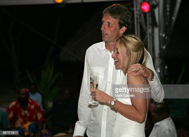 Newlyweds Tony Hawk and Lhotse Merriam look on as Rancid perform during their wedding reception January 12 2006 on the Island of Tavarua in Fiji