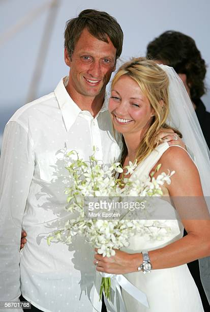 Newlyweds Tony Hawk and Lhotse Merriam pose for a photo at their wedding ceremony January 12 2006 on the Island of Tavarua in Fiji