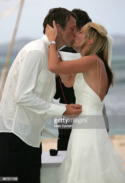 Newlyweds Tony Hawk and Lhotse Merriam share a kiss after their marriage January 12 2006 on the Island of Tavarua in Fiji