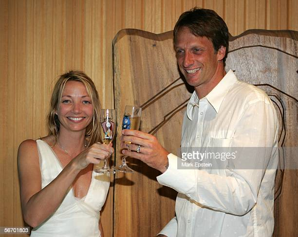Newlyweds Tony Hawk and Lhotse Merriam toast as they celebrate their marriage January 12 2006 on the Island of Tavarua in Fiji