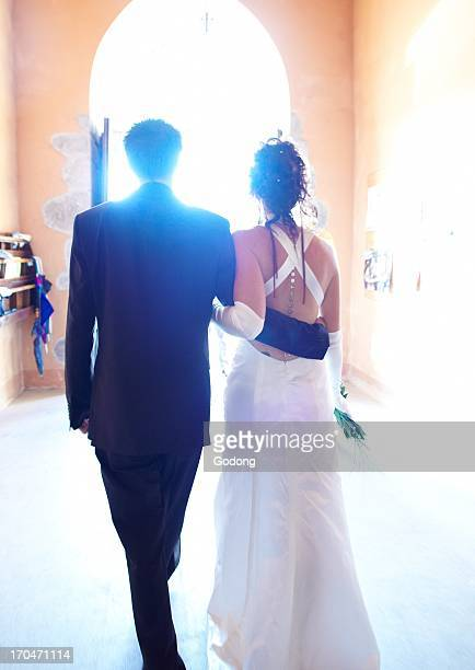 Newlyweds walking out of church France