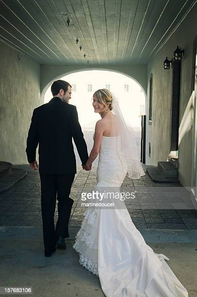 "newlyweds walking through a tunnel towards the light - ""martine doucet"" or martinedoucet stockfoto's en -beelden"