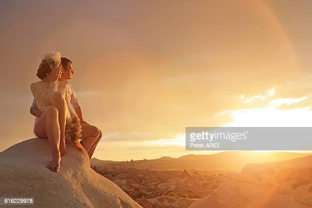 Newlyweds watching romantic sunset