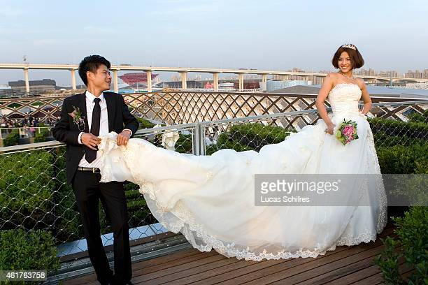 Newlyweds Zhao Xia and Lin Hua celebrate their wedding on the roof of the French Pavilion at Shanghai World Expo 2010 on May 11 2010 in Shanghai...