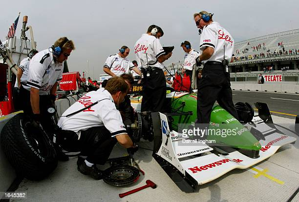 Newman Haas Racing mechanics make adjustments to the Toyota Lola of Christian Fittipaldi during practice for the Gran Premio GiganteTelmex round 19...
