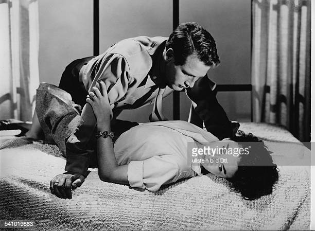 Newman Paul Actor USA * Scene from the movie 'Until They Sail'' with Jean Simmons Directed by Robert Wise USA 1957 Produced by MetroGoldwynMayer...