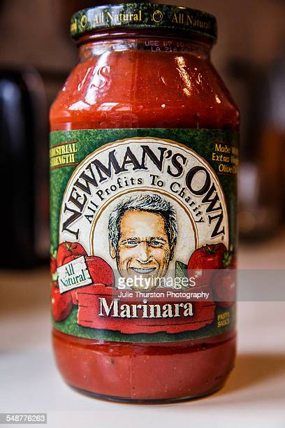 Newman's Own all natural Marinara sauce in a glass jar sitting on a kitchen counter ready to heat and serve over any pasta or meat dish All profits...