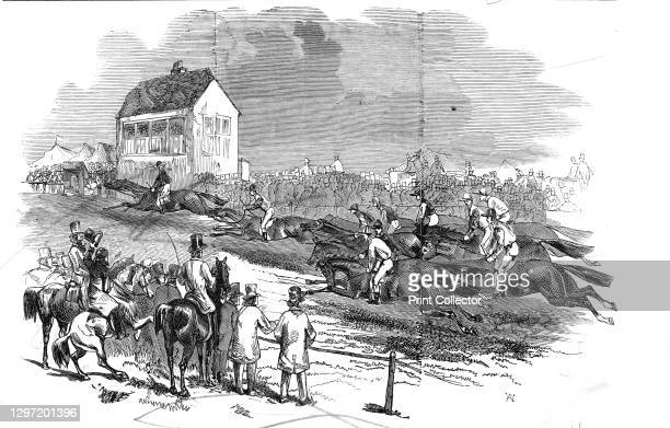"""Newmarket Races - the Cambridgeshire Stakes, 1845. Spectators watch the horse racing at Newmarket in Suffolk. From """"Illustrated London News"""" Vol VII...."""