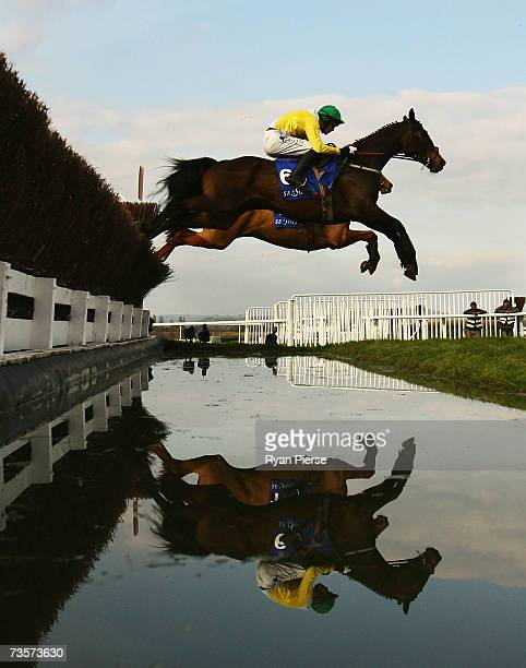 Newmill ridden by AJ McNamara clears a Steeple during the Queen Mother Champion Steeple Chase on the second day of The Annual National Hunt Festival...