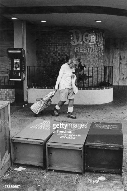 Newpaper vending machines brought down by Hurricane Andrew on Collins Avenue South Beach Miami Beach Florida 1992