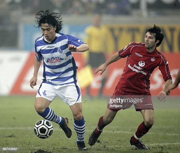 NewPlayer of Duisburg JungHwan Ahn takes on Sebastian Reinert during the Bundesliga match between MSV Duisburg and 1FC Kaiserslautern at the MSV...