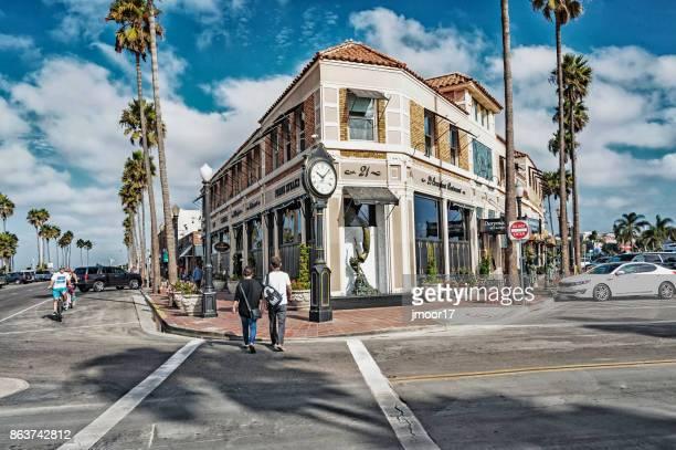 newport beach balboa village street view - newport beach california stock pictures, royalty-free photos & images