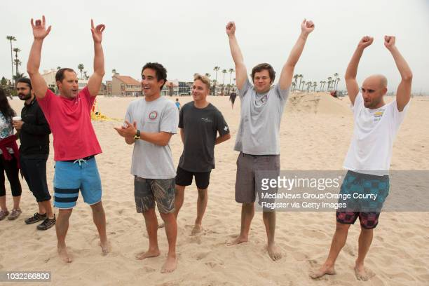 Newport Beach lifeguards Gary Conwell David McCabe Alex Brandt Tim Thomas and Jack Turner from left celebrate their victory after an obstacle course...