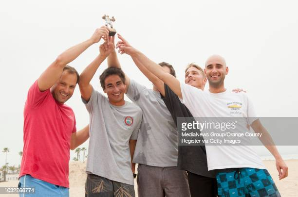 Newport Beach lifeguards Gary Conwell David McCabe Tim Thomas Alex Brandt and Jack Turner from left celebrate their victory after an obstacle course...