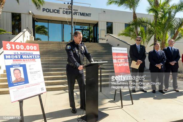 Newport Beach Police Department Chief of Police Jon T. Lewis, left, speaks during a news conference on Wednesday, September 19, 2018 in Newport...