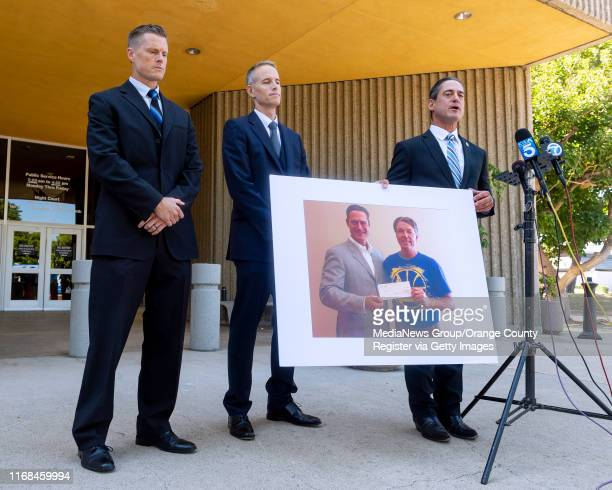 Newport Beach Police Sgt Ryan Peters Senior Deputy District Attorney Matt Murphy and District Attorney Todd Spitzer from left talk to the media...