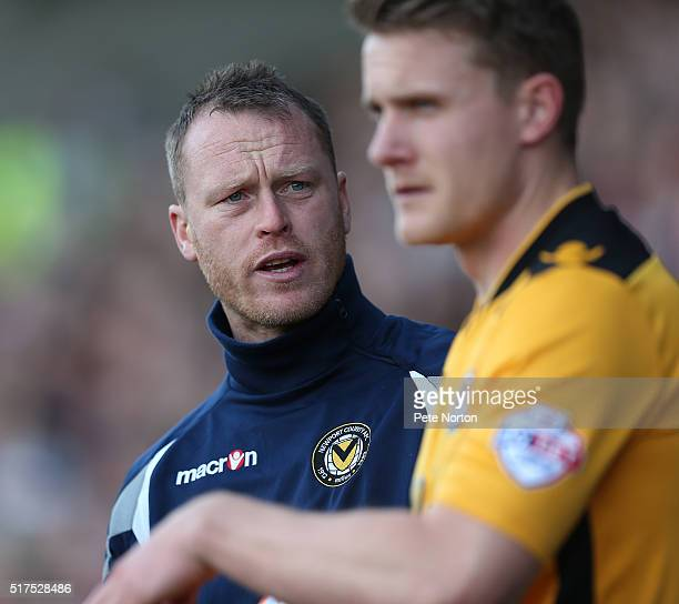 Newport County 1st team coach Michael Flynn makes a point to Yan Klukowski during the Sky Bet League Two match between Northampton Town and Newport...
