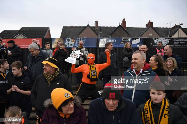 Newport County AFC fan enjoys the pre match atmosphere prior to the FA Cup Fifth Round match between Newport County AFC and Manchester City at Rodney...