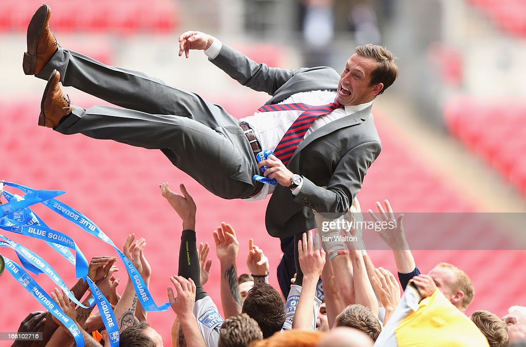 Newport County A.F.C manager Justin Edinburgh celebrates with the team after winning the Blue Square Bet Premier Conference Play-off Final between Wrexham and Newport County A.F.C at Wembley Stadium on May 5, 2013 in London, England.