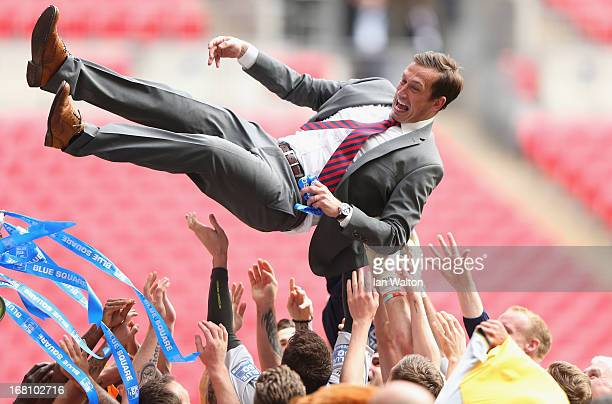 Newport County A.F.C manager Justin Edinburgh celebrates with the team after winning the Blue Square Bet Premier Conference Play-off Final between...