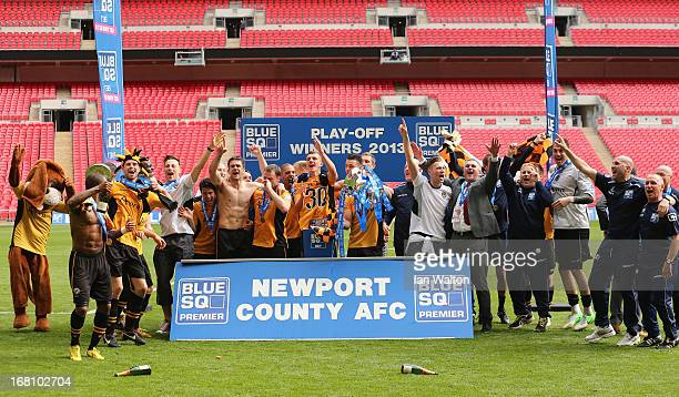 Newport County AFC team celebrates after winning the Blue Square Bet Premier Conference Playoff Final between Wrexham and Newport County AFC at...