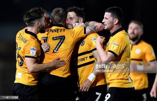 Newport County celebrate with their second goal scorer Robbie Willmott during the Sky Bet League Two match between Newport County and Oldham Athletic...