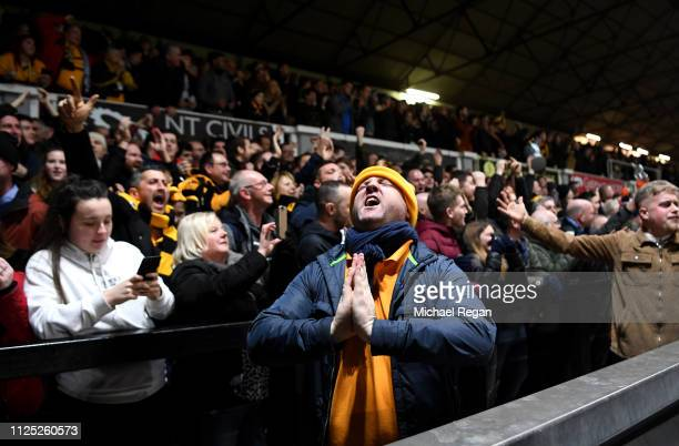 Newport County fans celebrate their team's first goal during the FA Cup Fifth Round match between Newport County AFC and Manchester City at Rodney...
