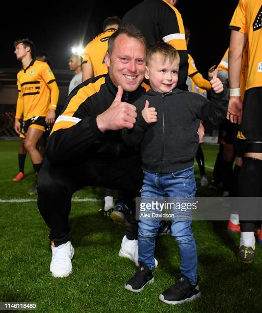 Newport County manager Michael Flynn poses for a photo with his son during the Sky Bet League Two match between Newport County and Oldham Athletic at...