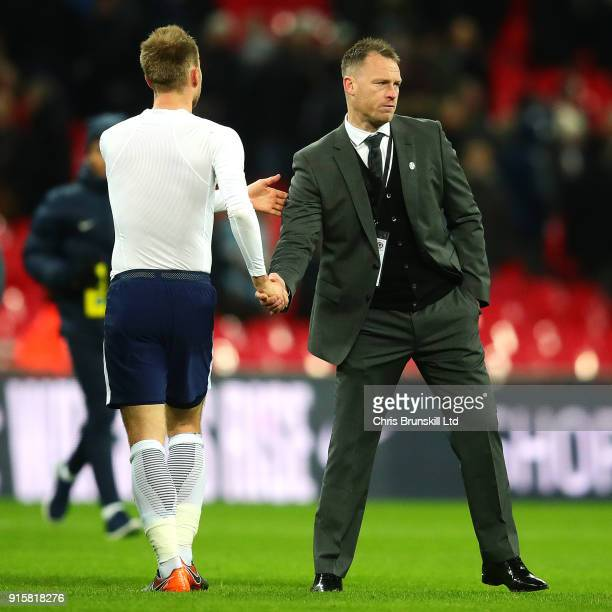 Newport County manager Michael Flynn shakes hands with Christian Eriksen of Tottenham Hotspur following the Emirates FA Cup Fourth Round Replay...
