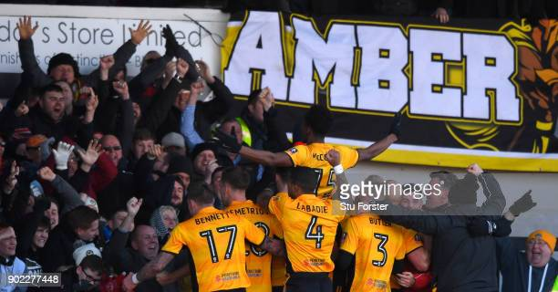 Newport County player Shawn McCoulsky celebrates his winning goal with fans and team mates during The Emirates FA Cup Third Round match between...