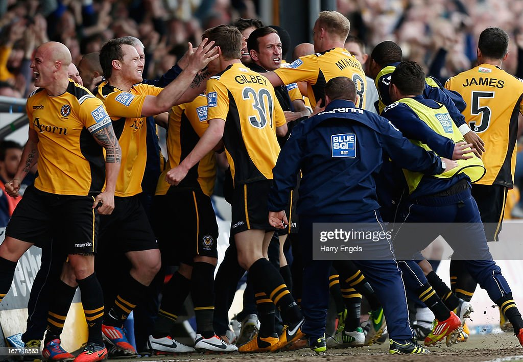 Newport County players celebrate after Christian Jolley scored their first goal during the Blue Square Bet Premier Conference Play-off second leg match between Newport County A.F.C. and Grimsby Town at Rodney Parade on April 28, 2013 in Newport, Wales.