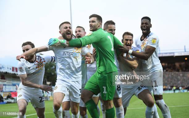 Newport County players celebrate after they beat Mansfield Town on penalties during the Sky Bet League Two Playoff Semi Final Second Leg match...