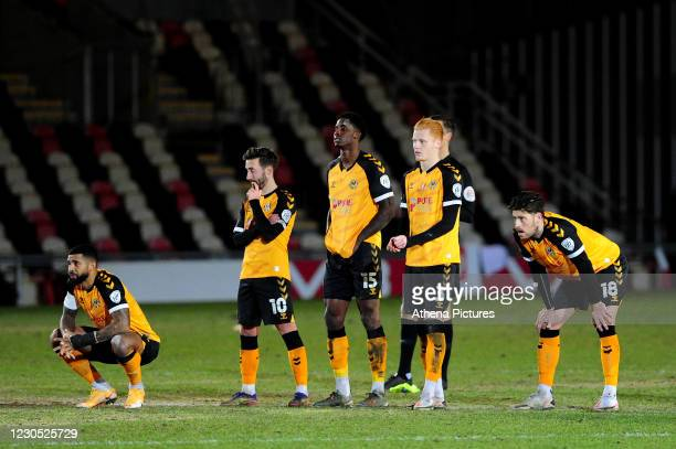 Newport County players look dejected during the FA Cup Third Round match between Newport County and Brighton And Hove Albion at Rodney Parade on...