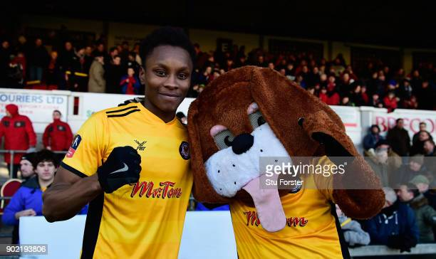 Newport County winning goalscorer Shawn McCoulsky celebrates with the club mascot Spytty after The Emirates FA Cup Third Round match between Newport...