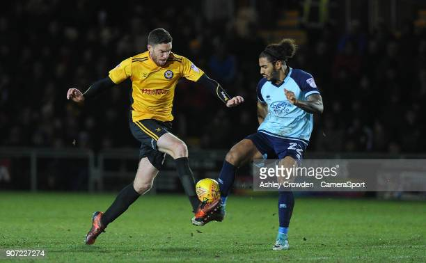 Newport County's Ben Tozer battles with Crawley Town's Josh Lelan during the Sky Bet League Two match between Newport County and Crawley Town at...