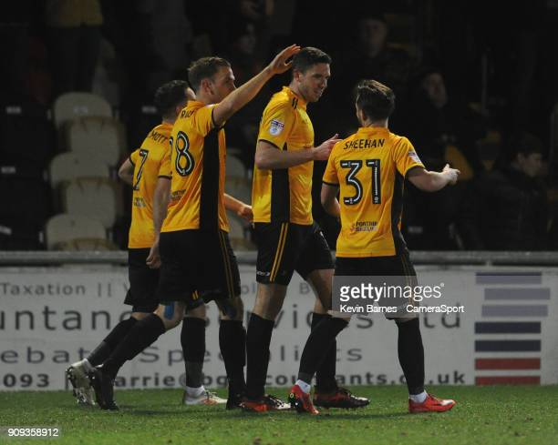 Newport County's Ben Tozer celebrates scoring his side's first goal with teammates Robbie Willmott Mickey Demetriou and Josh Sheehan during the Sky...